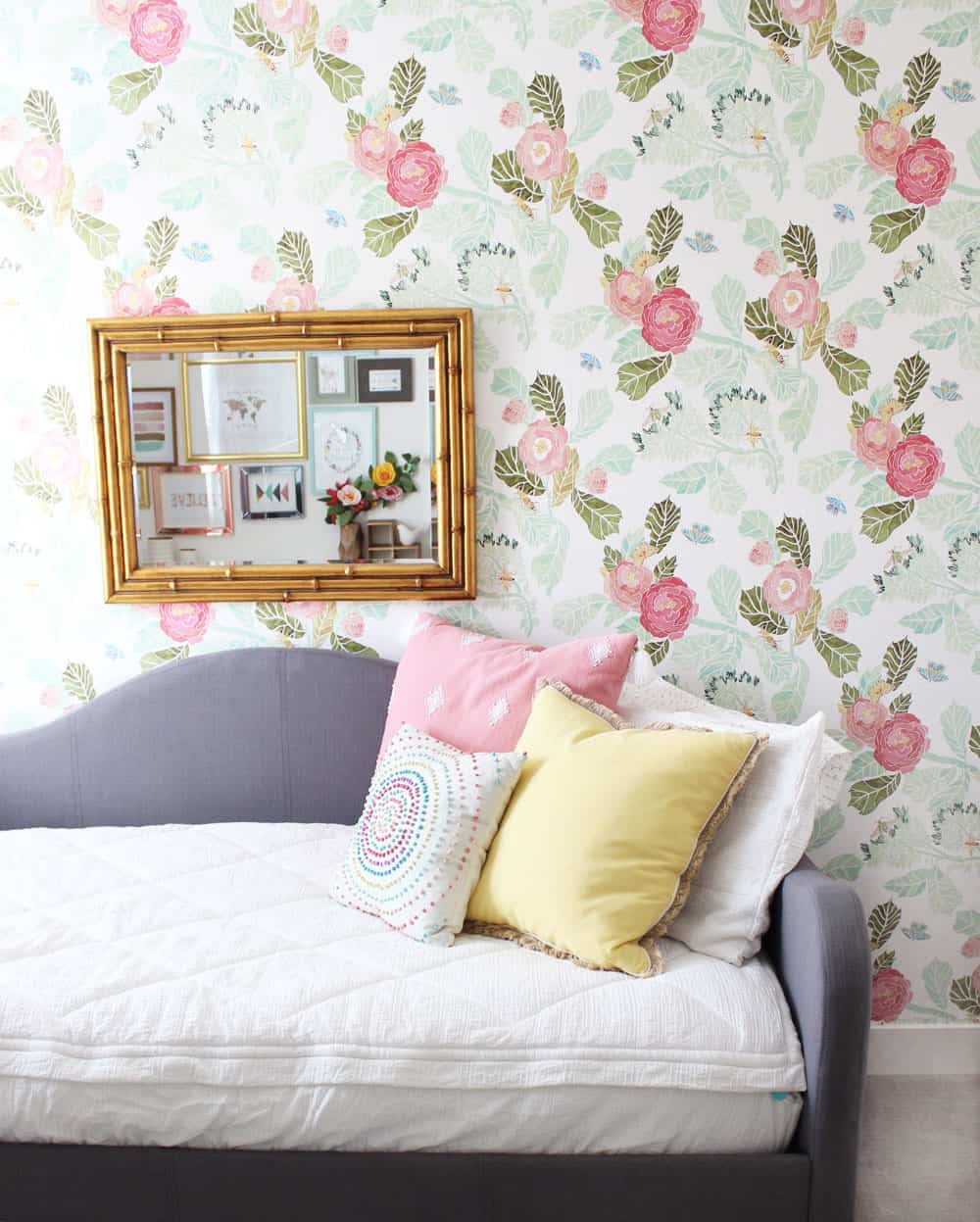 floral wallpaper with a gold mirror