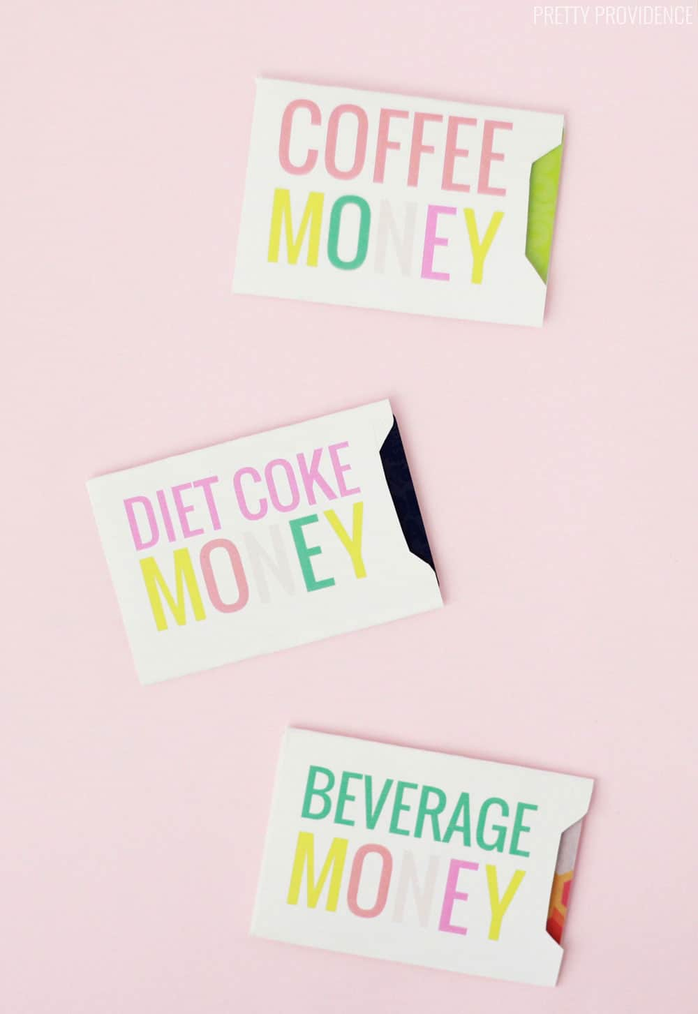 White gift card envelopes that say 'Diet Coke Money' 'Coffee Money' and 'Beverage Money' in colorful pink, green, yellow and coral letters, on a pink background.