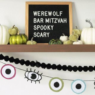 Halloween Decoration Eyeball Garland, Black Pom Pom Garland, Green and White Pumpkins on a Mantel