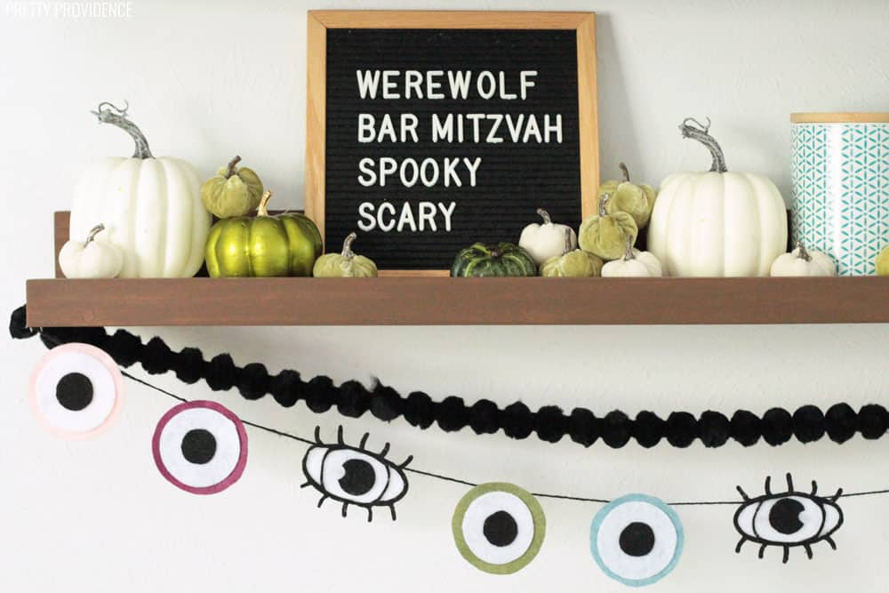 Halloween Decoration Eyeball Garland, Black Pom Pom Garland, Green and White Pumpkins on a Mantel
