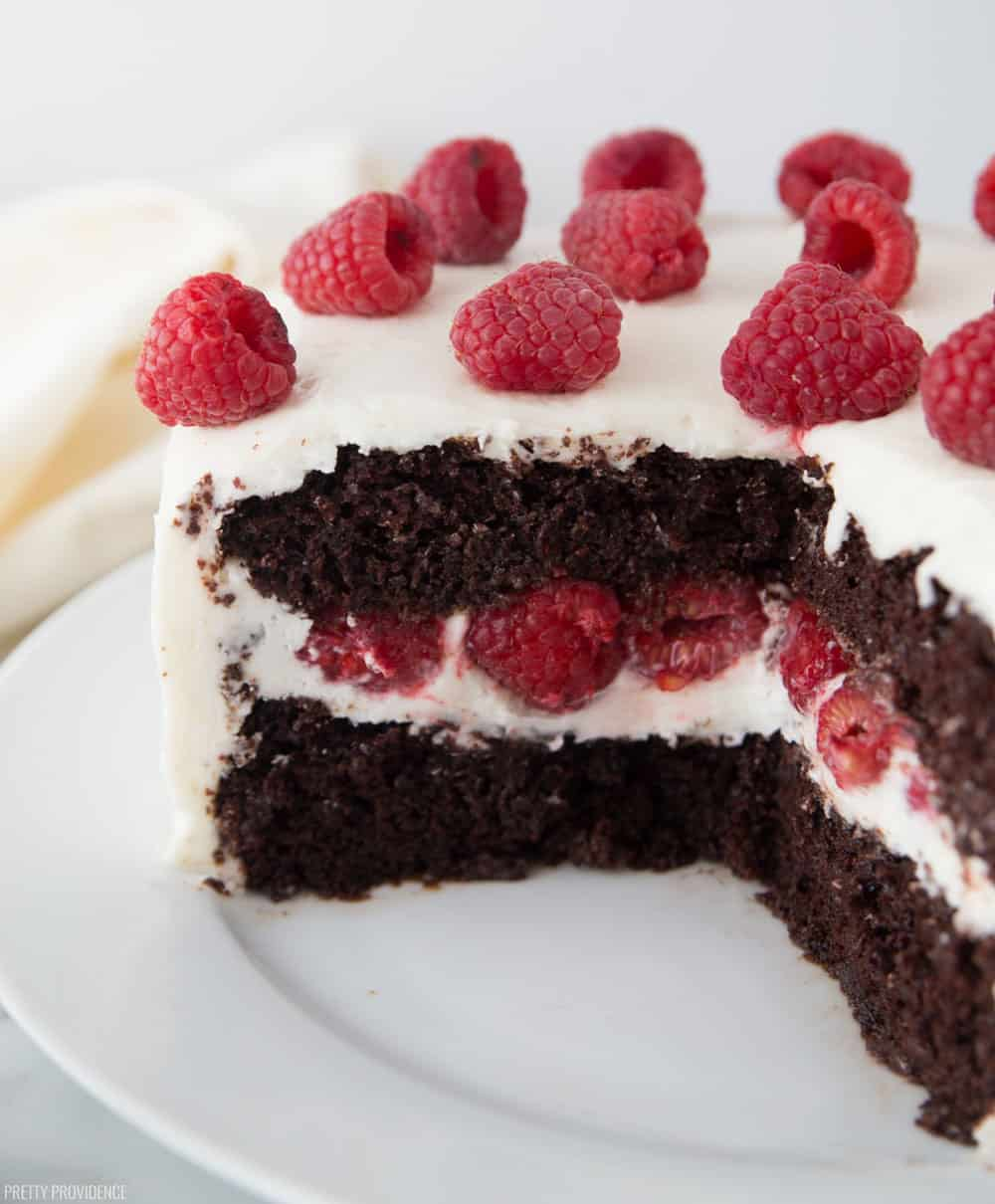 Chocolate Raspberry Cake with Cream Cheese Frosting and Fresh Raspberries in the middle and on top