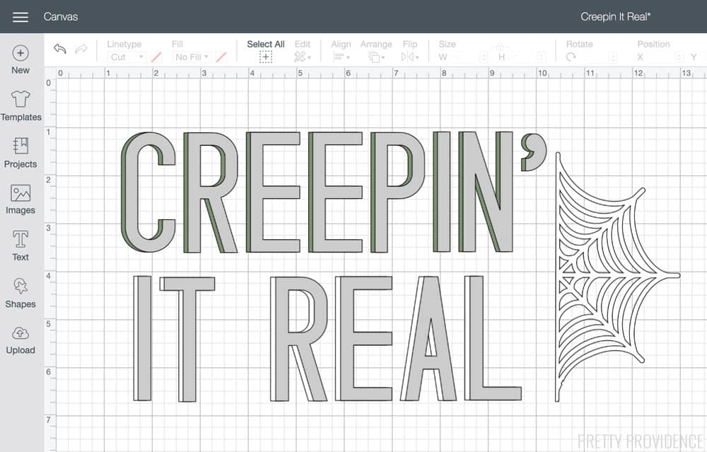The words 'Creepin' It Real' bold text with spiderweb on the side, Cricut design space canvas.