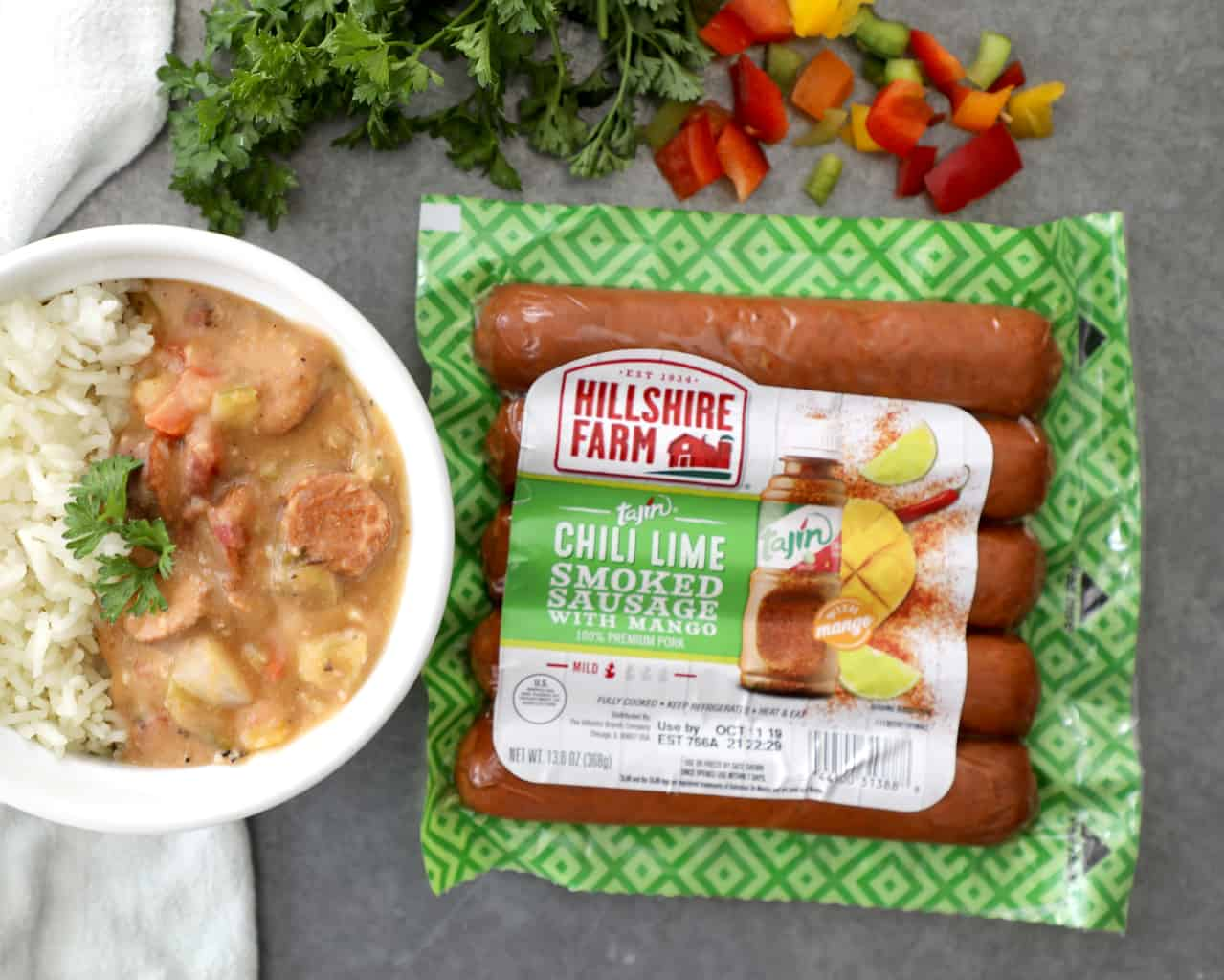 hillshire farms sausage and fresh veggies next to a bowl of gumbo