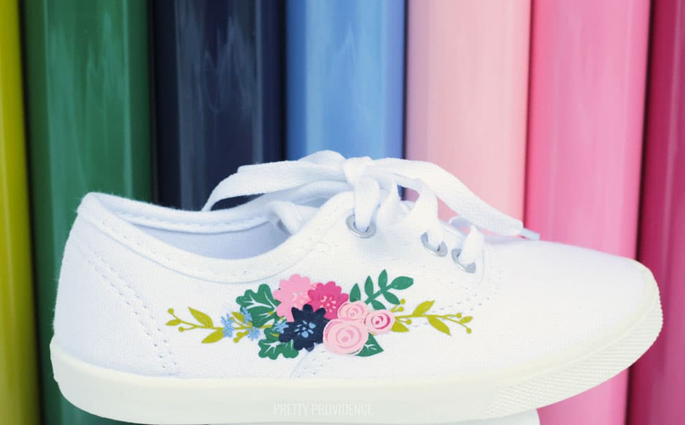 White shoe with floral design on the side, tutorial for how to Iron on to shoes.