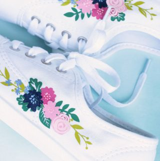 White Keds style shoes with floral motif in pink, blue, green and chartreuse similar to Rifle Paper Co Keds.