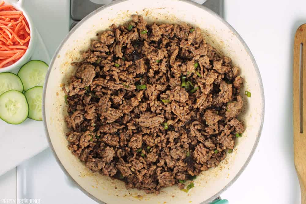 Korean ground beef, cooked and cooling in a pan.