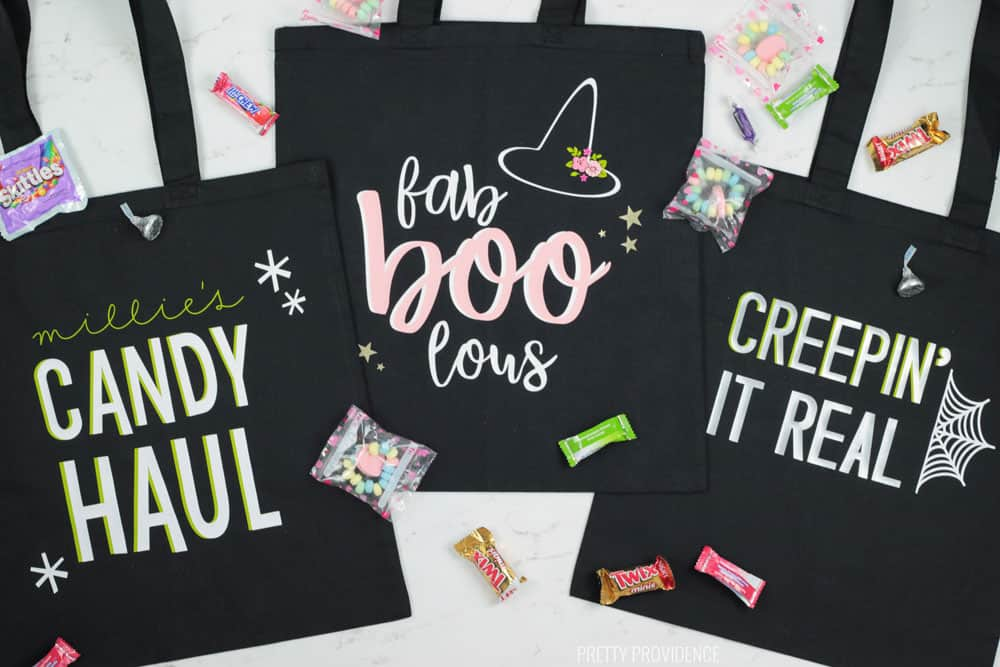 Three black Halloween Trick or Treat Bags with 'Candy Haul' 'Fab Boo Lous' and Creepin' it real' phrases on them.