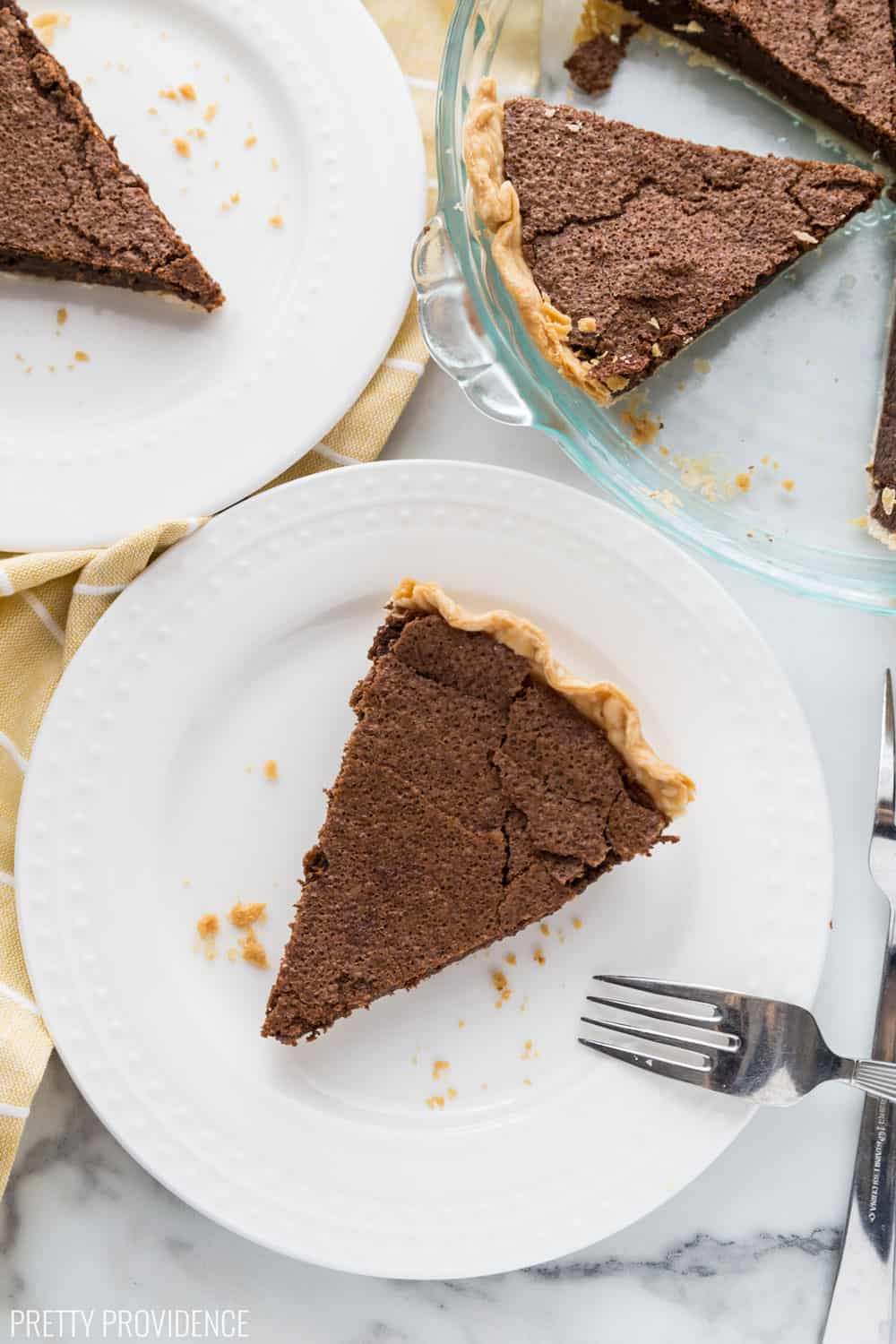 Chocolate Chess Pie slices on white dessert plates.