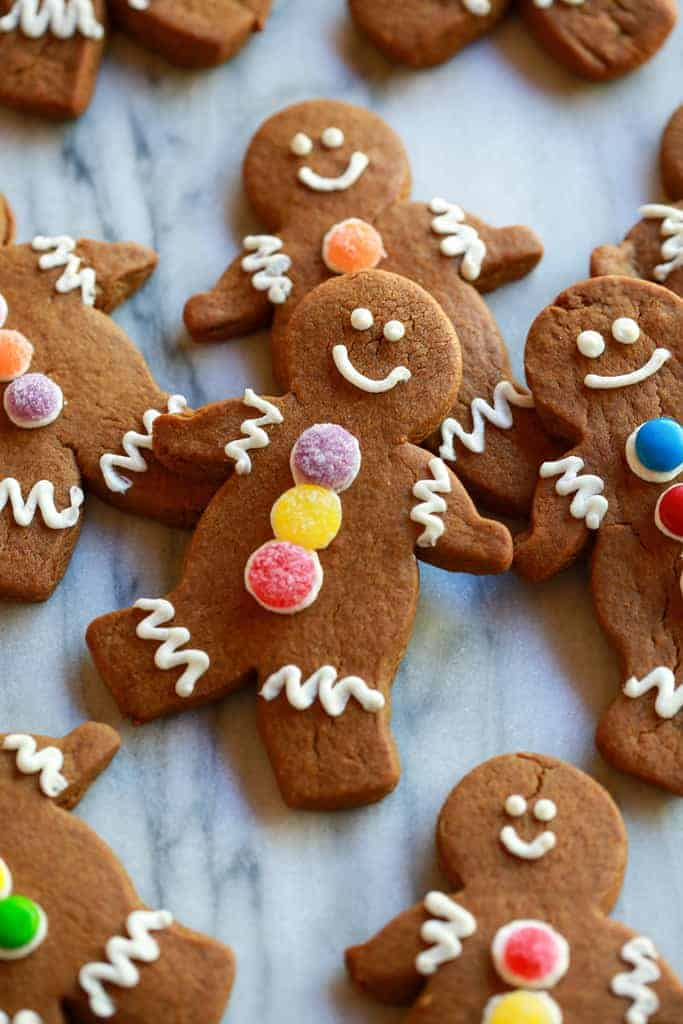 Gingerbread man cookies with white icing and candy buttons