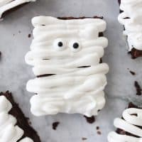 mummy brownie with candy eyeballs on a granite countertop