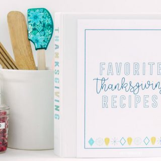 Thanksgiving meal planner binder, white kitchen utensil holder and prepared chopped vegetables in clear plastic containers.