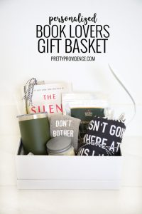 a gift basket filled with items for a reader against a white backdrop with pinterest text