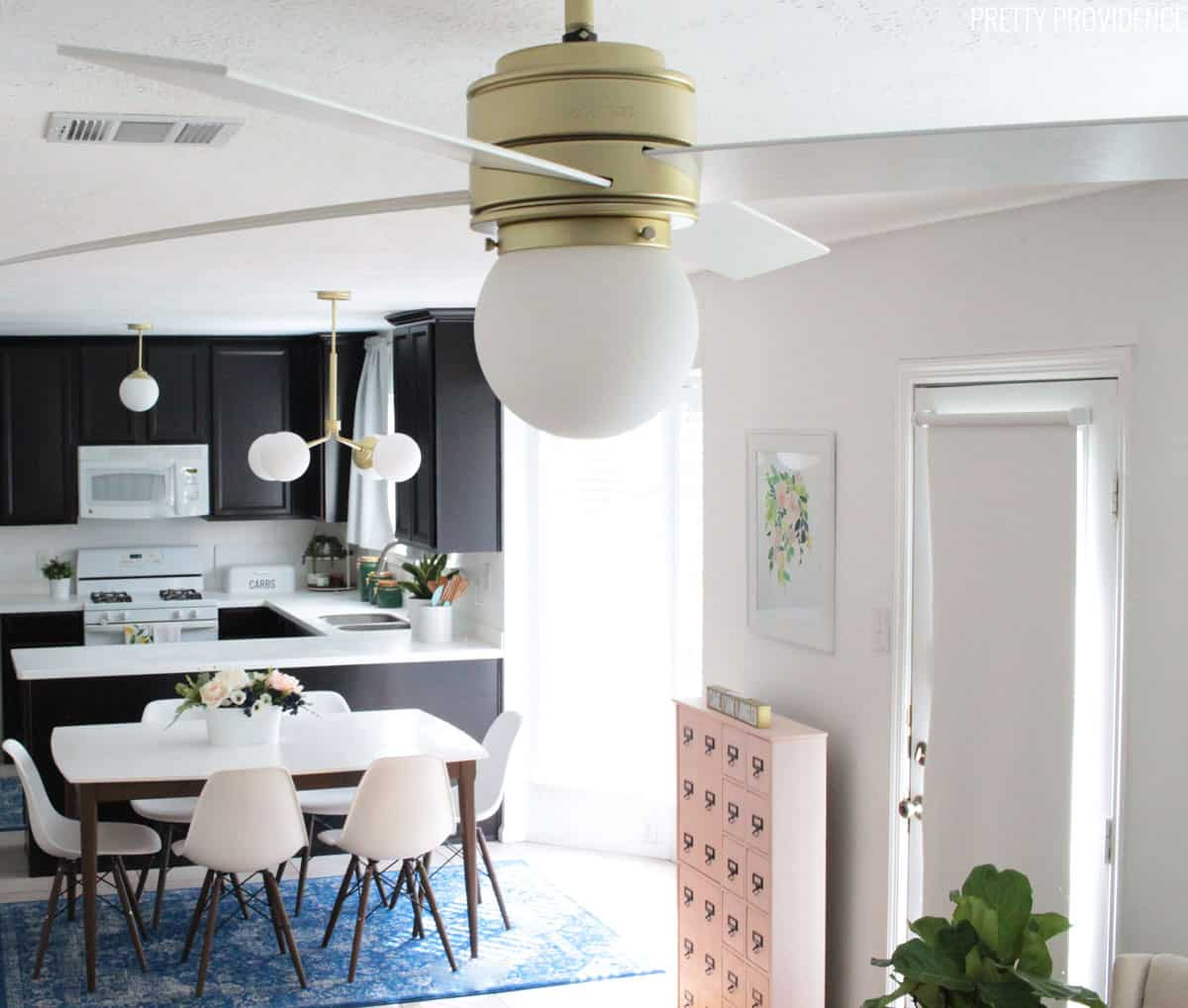 Hunter fan hepburn style with hepburn chandelier and pendant light in the background.
