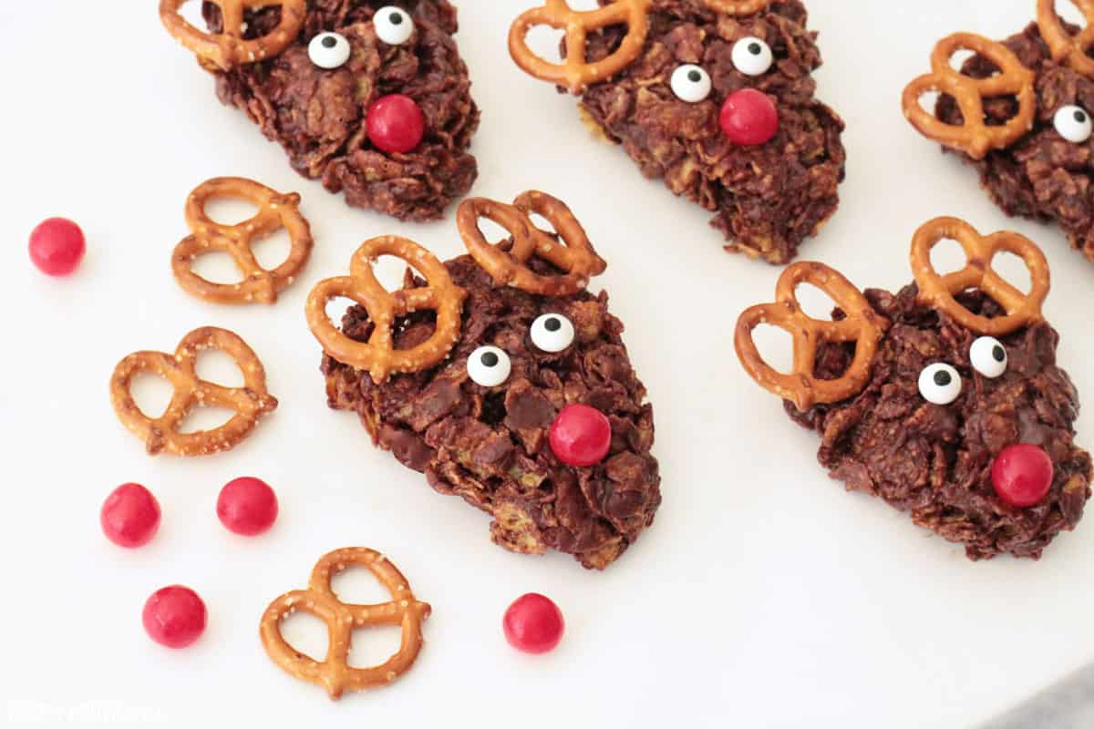 Reindeer cookies with pretzels and red candies for noses.