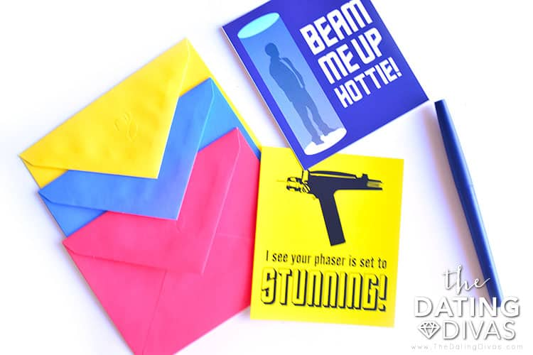 """Star Trek themed valentines - a blue card that reads 'beam me up hottie!' and a yellow one - """"I see your phaser is set to stunning!"""" on a white surface."""