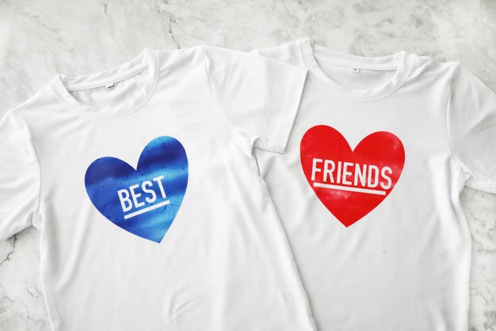 "one t shirt with a blue heart that says ""best"" and one with a red heart that says ""friends"""