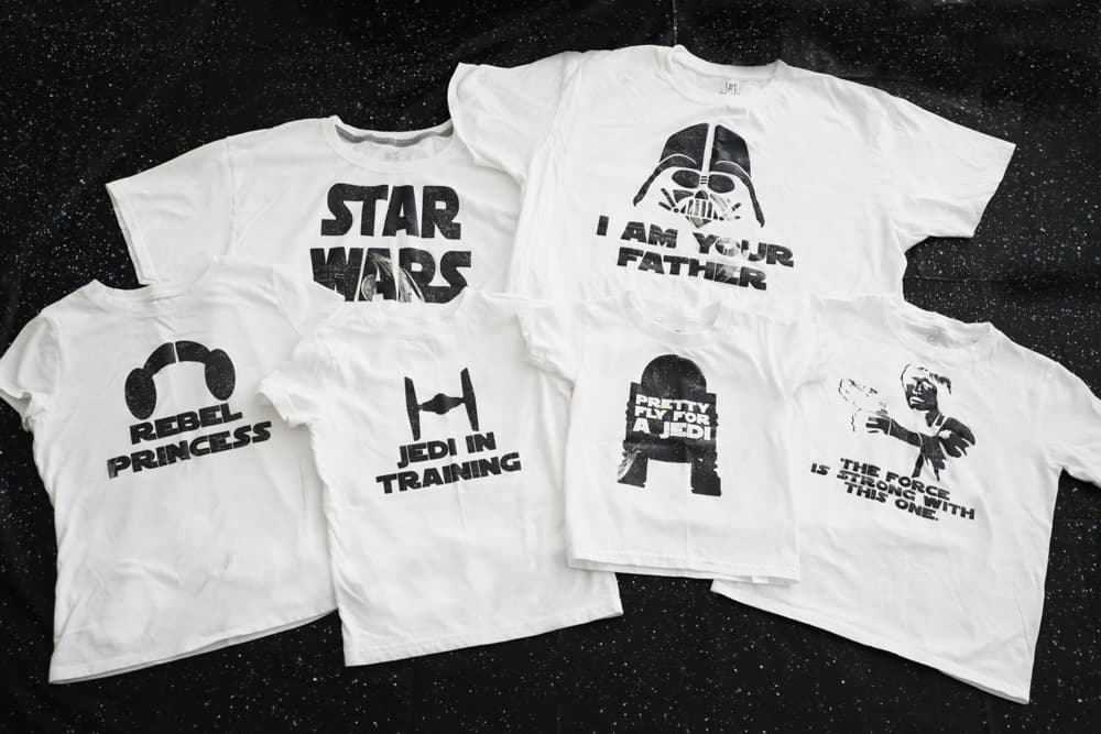 six different white star wars shirts against a black background with stars