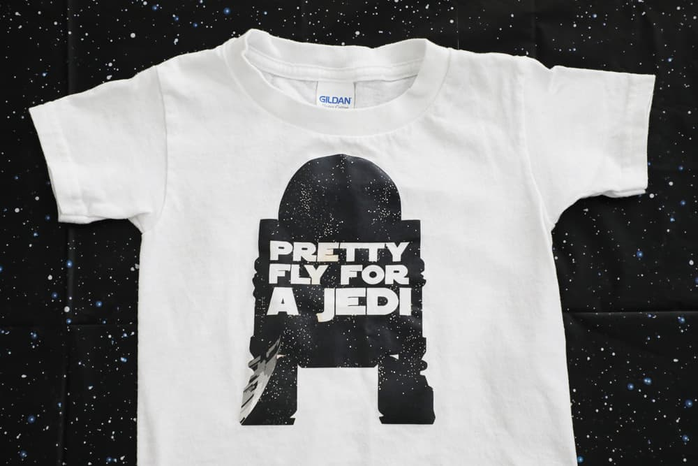 "white t shirt with R2D2 sillouette with the words ""pretty fly for a jedi"""