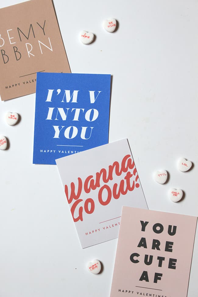 """Four printable valentines with retro fonts that read """"I'm v into you"""" """"wanna go out?"""" """"you are cute AF"""" and """"Be My BB RN"""""""