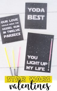 Star Wars printable valentines 'yoda best' 'you light up my life' with glow stick light sabers on a white surface.