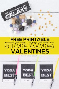 Star Wars printable valentines 'yoda best' with glow stick light sabers on a white surface and treat bag toppers 'together we can rule the world.'
