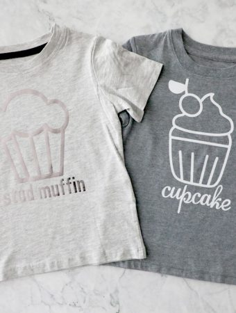 "two grey t shirts next to each other, one says ""stud muffin"" one says ""cupcake"""