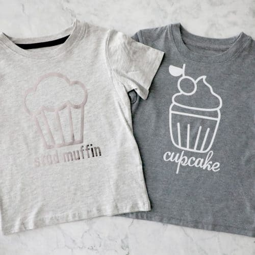"""two grey t shirts next to each other, one says """"stud muffin"""" one says """"cupcake"""""""