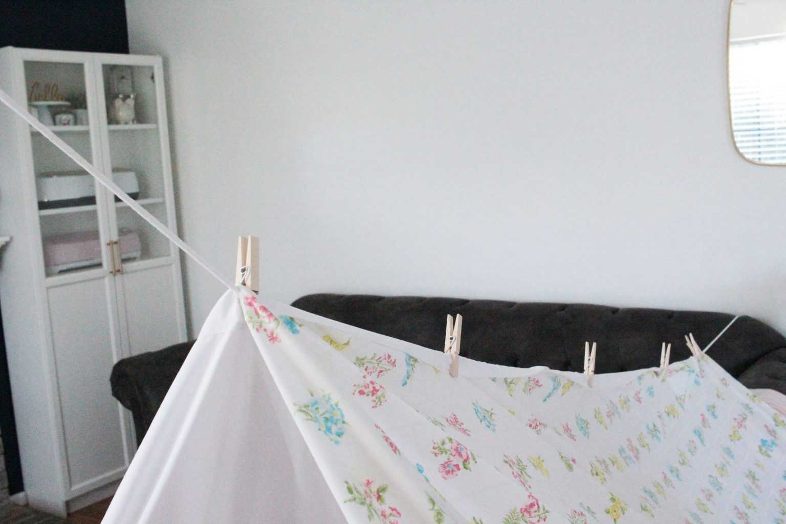 How to make a fort with clothes line or rope, clothes pins, and bed sheets.