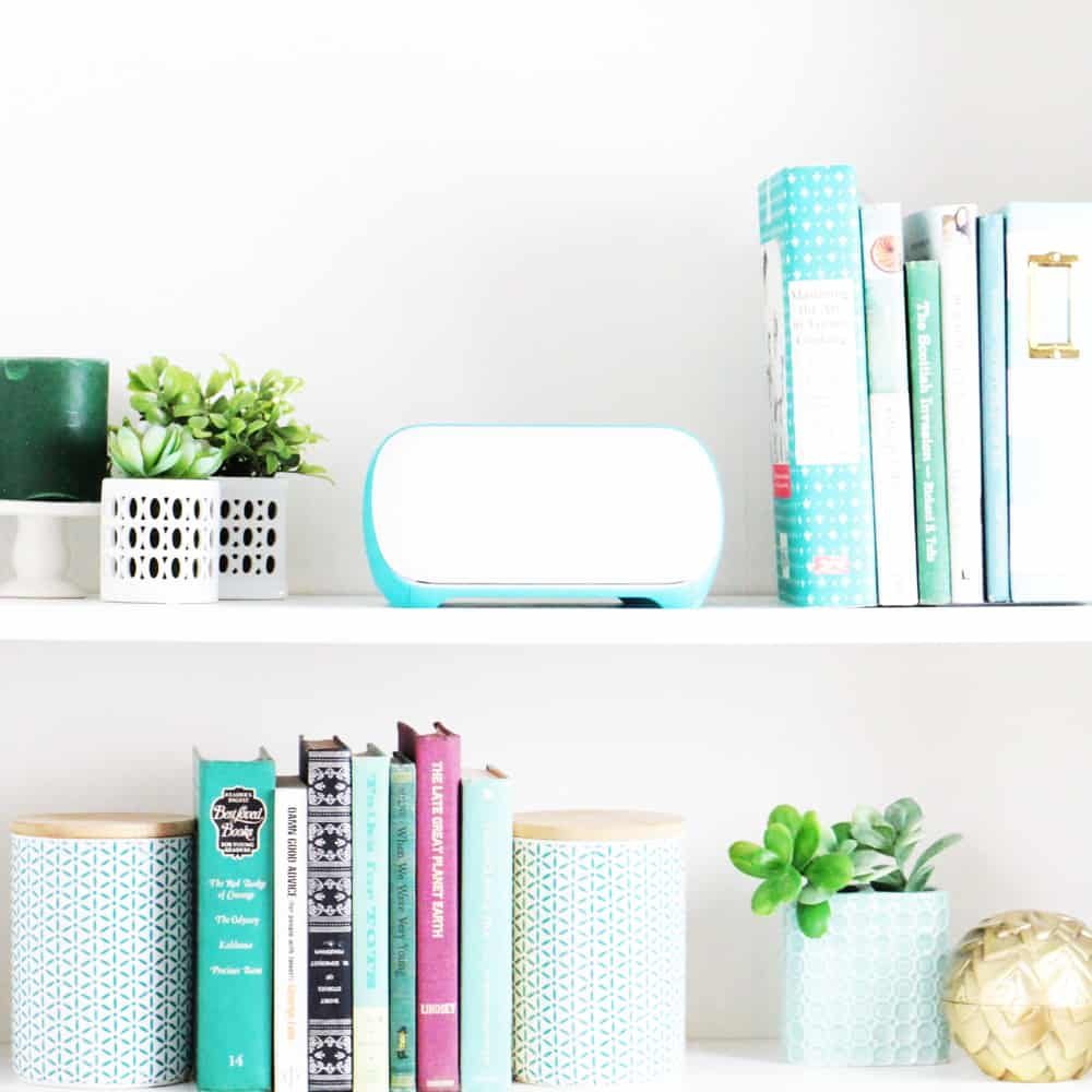 styled bookshelves with books, plants and the Cricut Joy