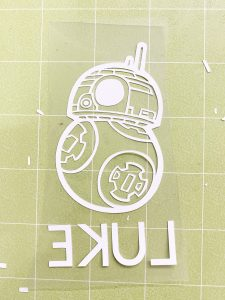 weeded iron on bb8 on a green cricut cutting mat