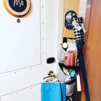 a full fish extender hanging by a stateroom door on a disney cruise