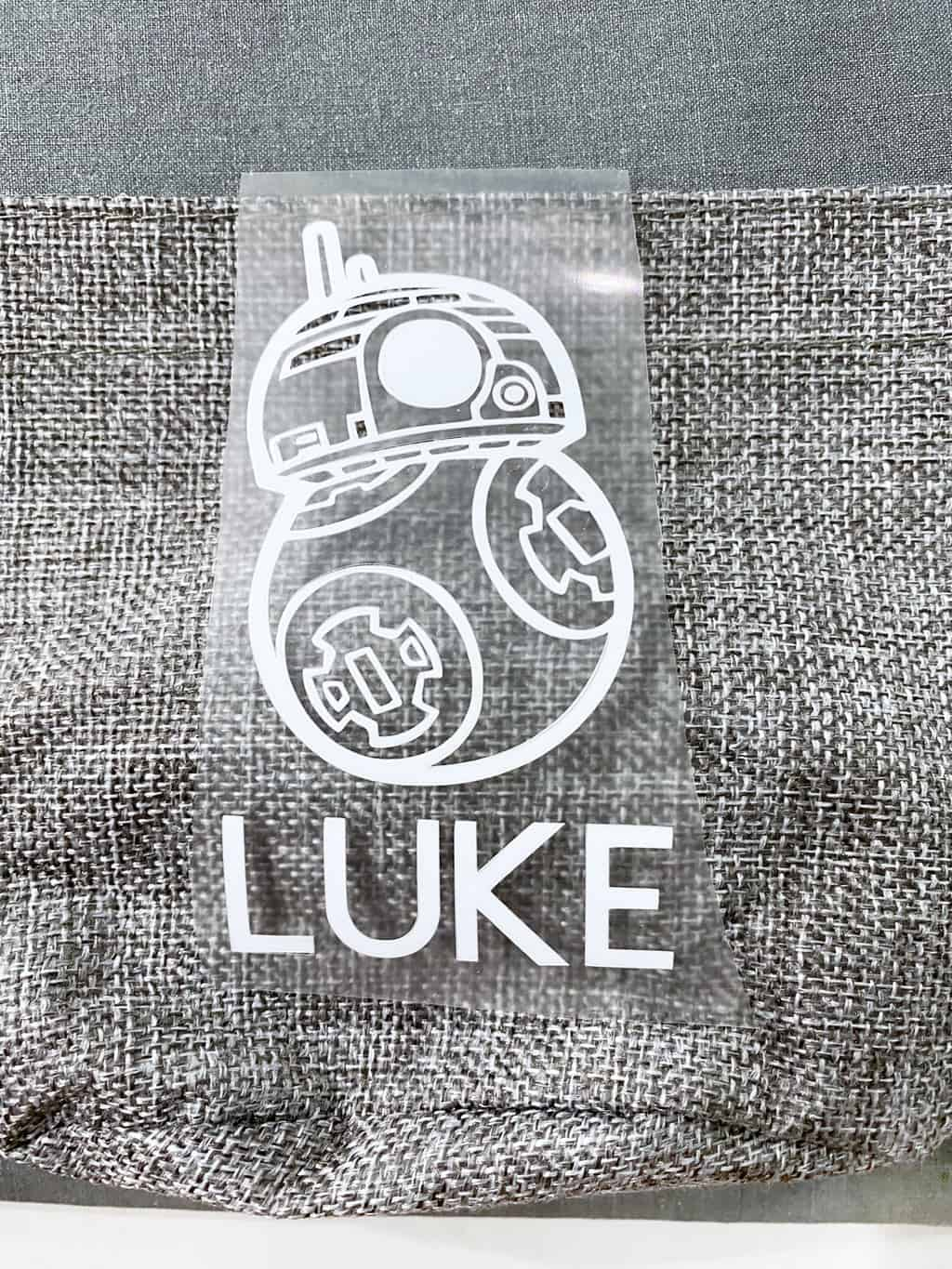 white iron-on bb8 on top of a grey fish extender bag