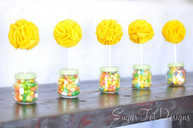 Topiaries with jelly beans in little baby food jars with yellow felt flowers