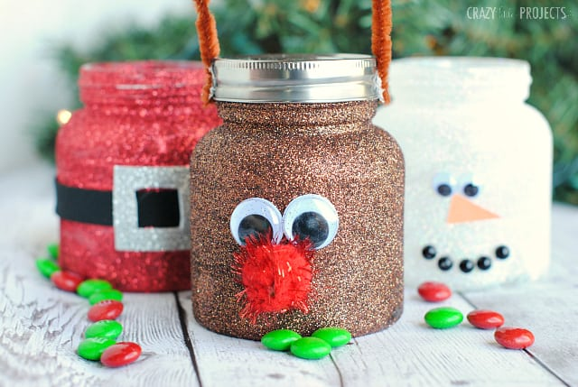 Christmas treat jars decorated to look like rudolph, snowman and santa.