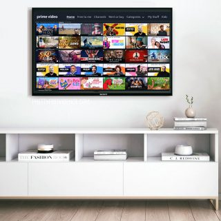 Amazon Prime TV menu on a flat screen TV above a white media console