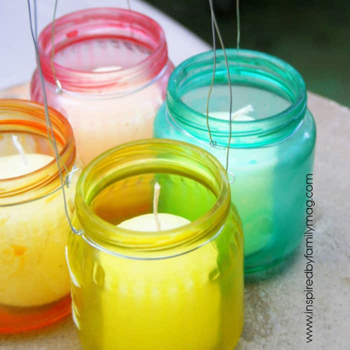colorful dyed glass jars with candles in them