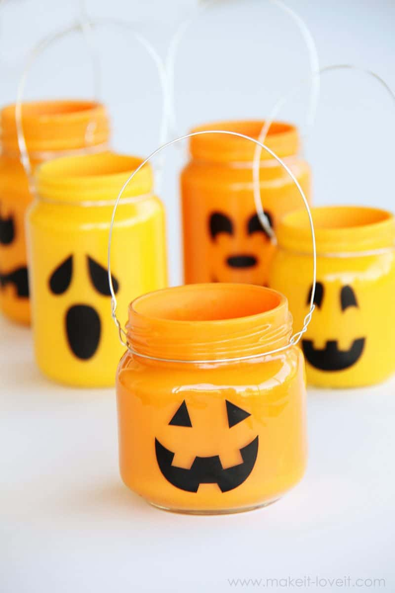 Baby food jars painted to look like pumpkins and jack-o-lanterns for halloween decoration.