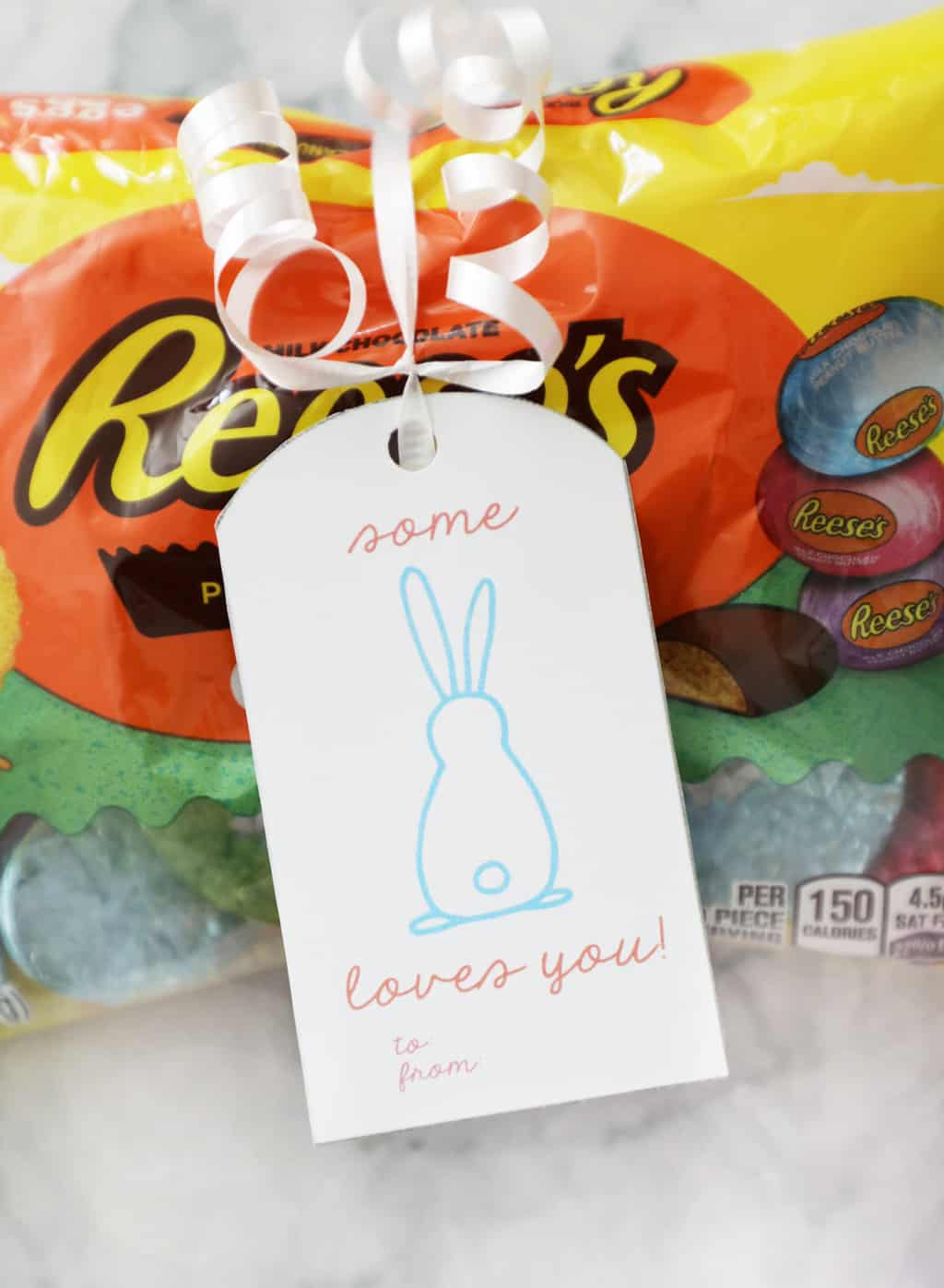 some bunny loves you tag tied on a bag of Reeses eggs