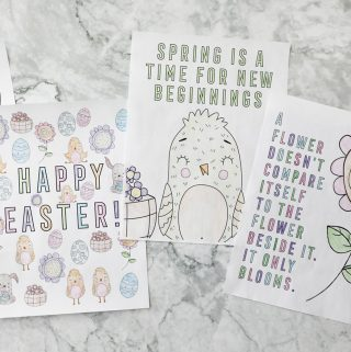 three colored spring coloring pages on a white marble countertop