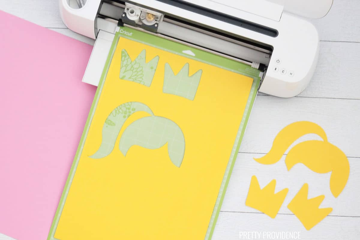 yellow sheet of craft foam and shapes cut out with Cricut Maker,