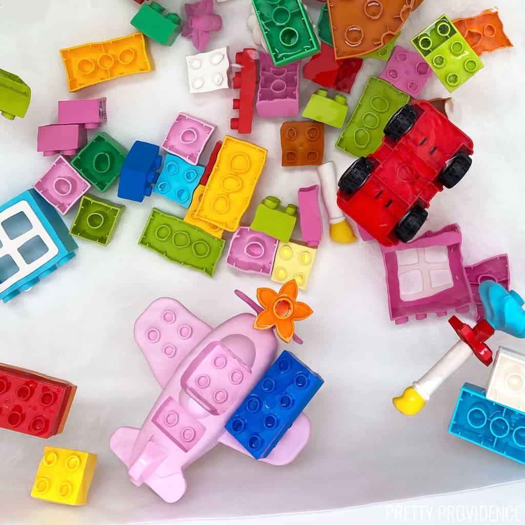Bathtub with water and lego duplos floating in the water - great toddler bath activity