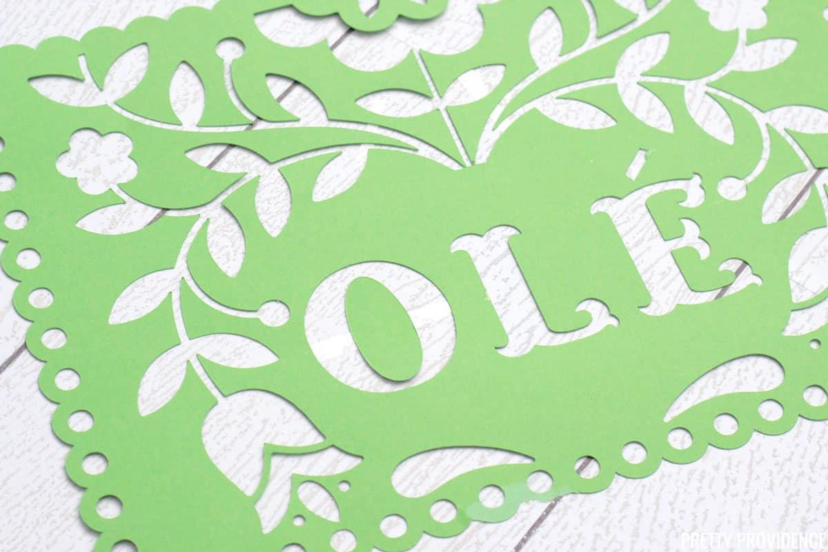 Green Papel Picado banner close up