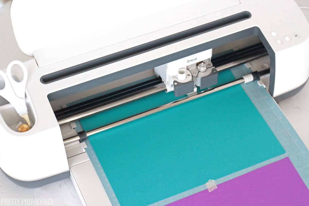 Cricut maker cutting teal and purple card stock