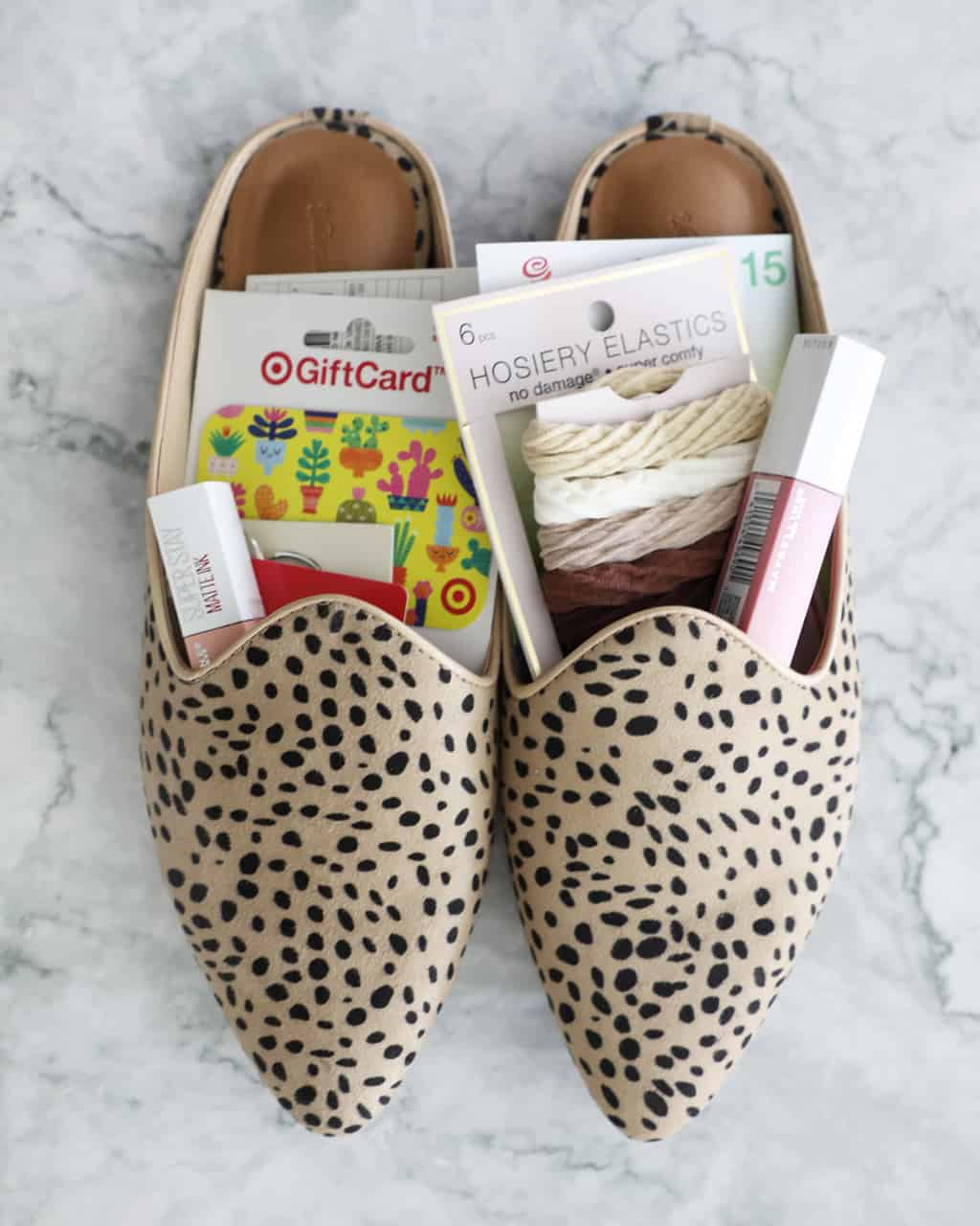 leopard flats stuffed with small gifts and gift cards