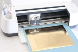 Cricut Maker cutting gold foil paper