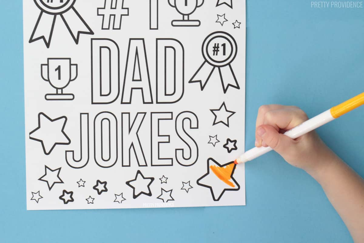 #1 Dad Jokes coloring page for Father's day with little hand coloring a star with a yellow marker.