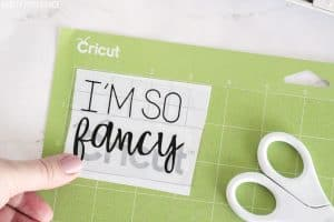 Cricut vinyl 'I'm So Fancy' with transfer tape over it