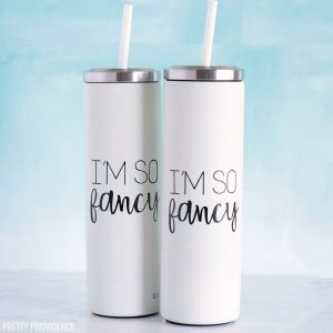 Two personalized yeti tumblers, white with black tumbler decal with Cricut vinyl