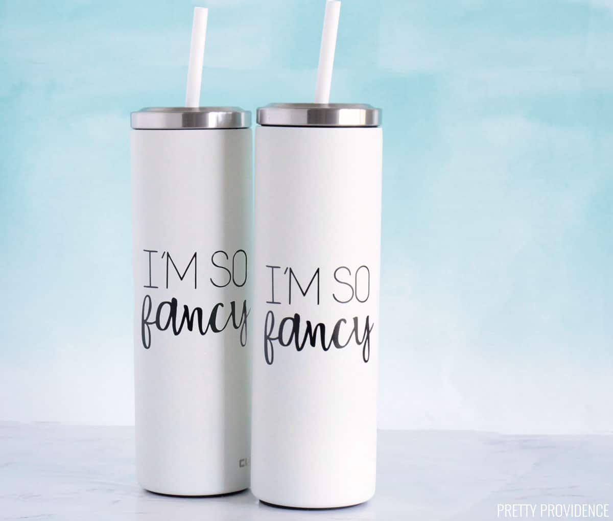 Personalized tumblers with straws - white with black Cricut vinyl that says 'I'm So Fancy'