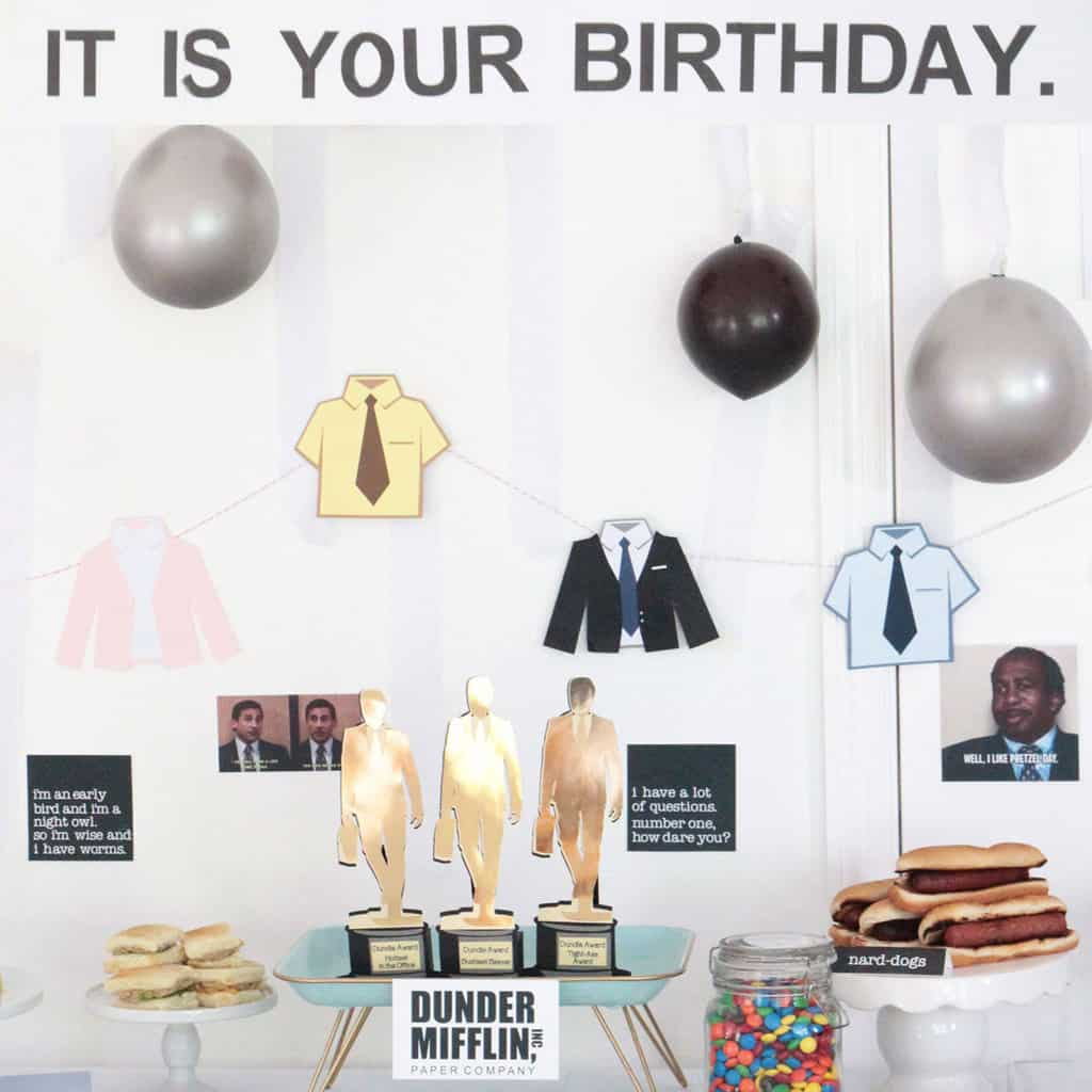 The office birthday party theme with 'It Is Your Birthday' sign, dundies, themed food and balloons.